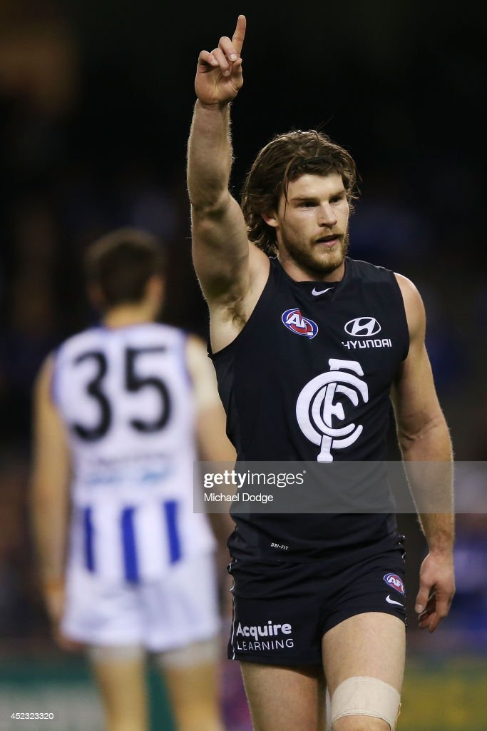 Bryce Gibbs of the Blues celebrates a goal during the round 18 AFL match between the Carlton Blues and the North Melbourne Kangaroos at Etihad Stadium on July 18, 2014 in Melbourne, Australia.