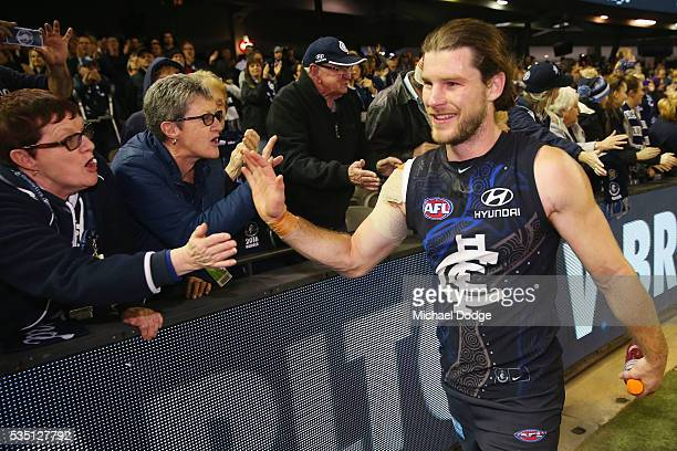 Bryce Gibbs of the Blues celebrates the win with fans during the round 10 AFL match between the Carlton Blues and the Geelong Cats at Etihad Stadium...