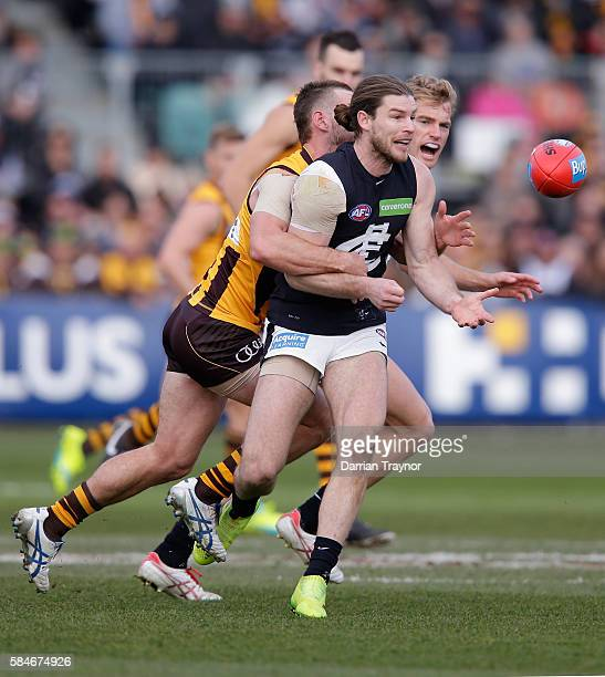Bryce Gibbs of the Blues gets a handball away during the round 19 AFL match between the Hawthorn Hawks and the Carlton Blues at Aurora Stadium on...