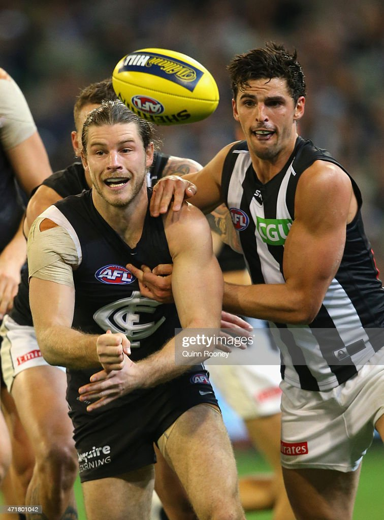 Bryce Gibbs of the Blues handballs whilst being tackled by Scott Pendlebury of the Magpies during the round five AFL match between the Carlton Blues and the Collingwood Magpies at Melbourne Cricket Ground on May 1, 2015 in Melbourne, Australia.