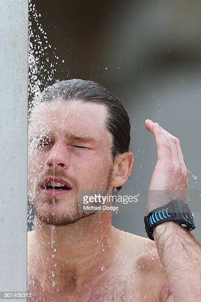 Bryce Gibbs of the Blues showers after a recovery session a the beach during the Carlton Blues AFL preseason training camp on December 15 2015 in...
