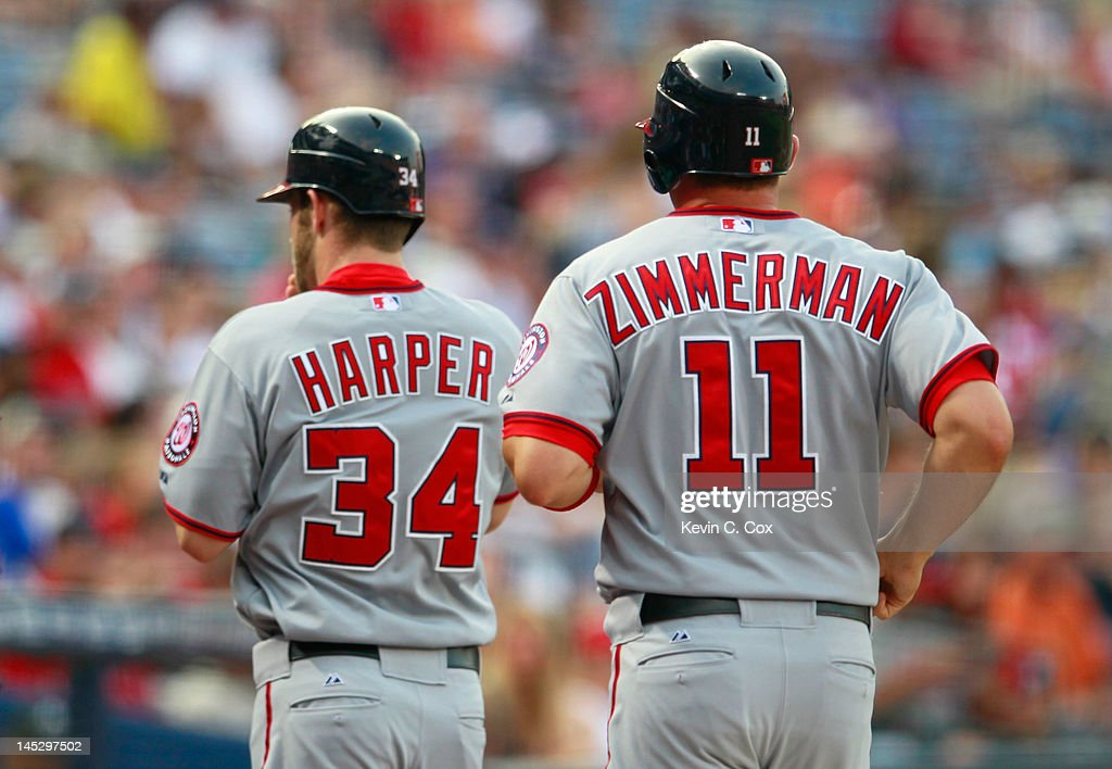 <a gi-track='captionPersonalityLinkClicked' href=/galleries/search?phrase=Bryce+Harper&family=editorial&specificpeople=5926486 ng-click='$event.stopPropagation()'>Bryce Harper</a> #34 and <a gi-track='captionPersonalityLinkClicked' href=/galleries/search?phrase=Ryan+Zimmerman+-+Baseball+Player&family=editorial&specificpeople=534809 ng-click='$event.stopPropagation()'>Ryan Zimmerman</a> #11 of the Washington Nationals head to the dugout after scoring in the first inning against the Atlanta Braves at Turner Field on May 25, 2012 in Atlanta, Georgia.