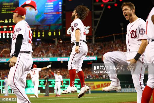 Bryce Harper and the Nationals bench celebrate after Ryan Zimmerman hit a threerun home run in the eighth inning during Game 2 of the National League...