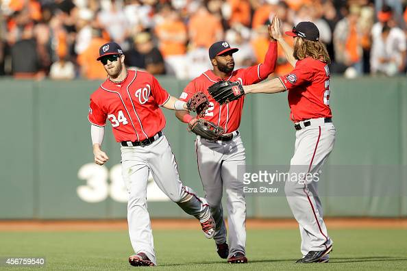 Bryce Harper celebrates with Denard Span and Jayson Werth of the Washington Nationals after their 4 to 1 win over the San Francisco Giants during...