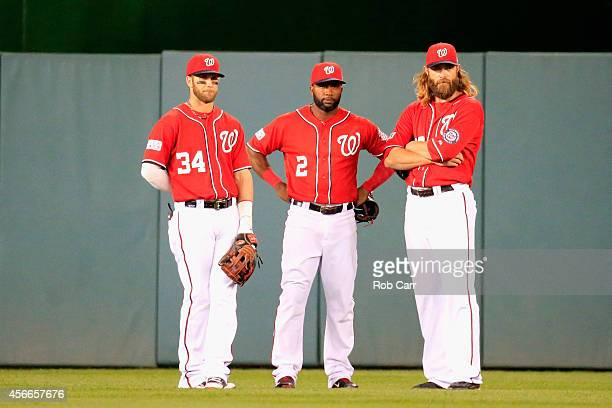 Bryce Harper Denard Span and Jayson Werth of the Washington Nationals look on during a pitching change in the twelfth inning against the San...