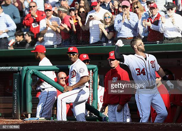 Bryce Harper of the Washington Nationals acknowledges the crowd after hitting a third inning grand slam against the Atlanta Braves at Nationals Park...