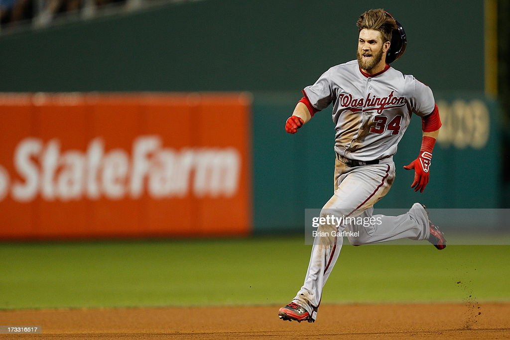 <a gi-track='captionPersonalityLinkClicked' href=/galleries/search?phrase=Bryce+Harper&family=editorial&specificpeople=5926486 ng-click='$event.stopPropagation()'>Bryce Harper</a> #34 of the Washington Nationals advances to third after hitting a triple in the sixth inning of the game against the Philadelphia Phillies at Citizens Bank Park on July 11, 2013 in Philadelphia, Pennsylvania.