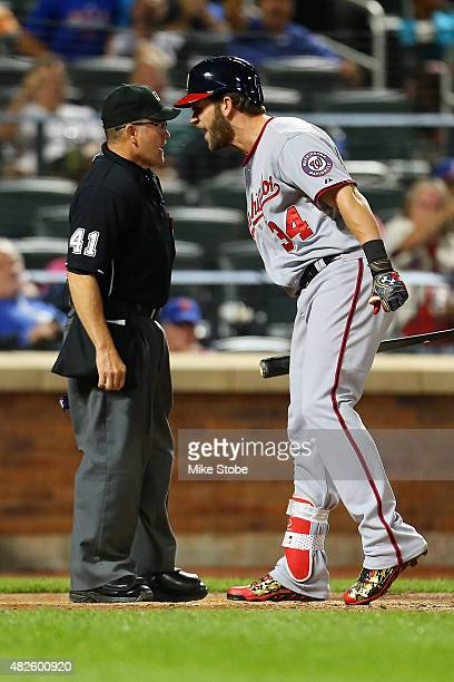Bryce Harper of the Washington Nationals agures with umpire Jerry Meals after being called out on strikes in the eleventh inning at Citi Field on...
