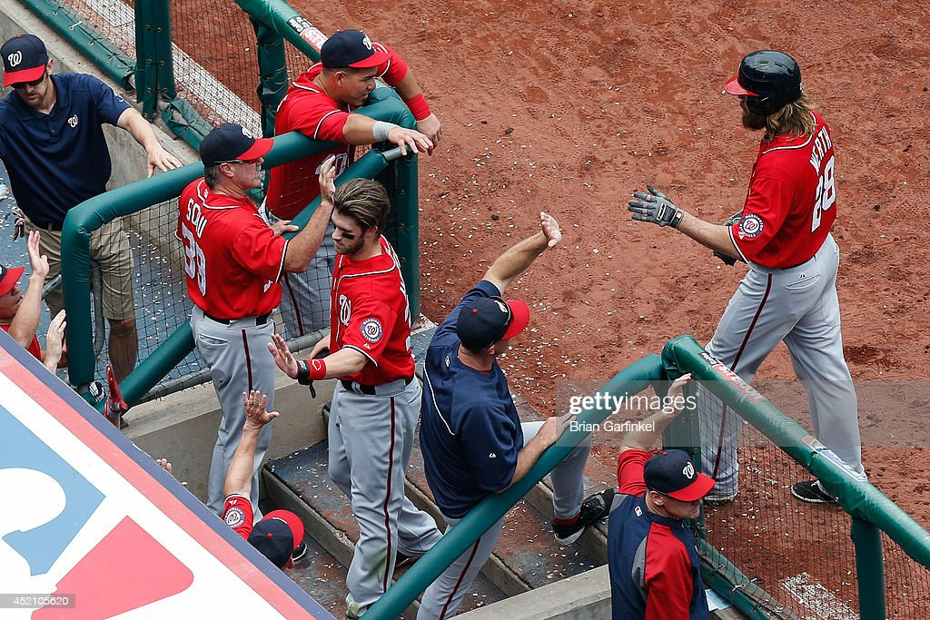 <a gi-track='captionPersonalityLinkClicked' href=/galleries/search?phrase=Bryce+Harper&family=editorial&specificpeople=5926486 ng-click='$event.stopPropagation()'>Bryce Harper</a> #34 of the Washington Nationals and <a gi-track='captionPersonalityLinkClicked' href=/galleries/search?phrase=Jayson+Werth&family=editorial&specificpeople=206490 ng-click='$event.stopPropagation()'>Jayson Werth</a> #28 of the Washington Nationals are congratulated by teammates in the dugout after scoring in the sixth inning of the game against the Philadelphia Phillies at Citizens Bank Park on July 13, 2014 in Philadelphia, Pennsylvania.