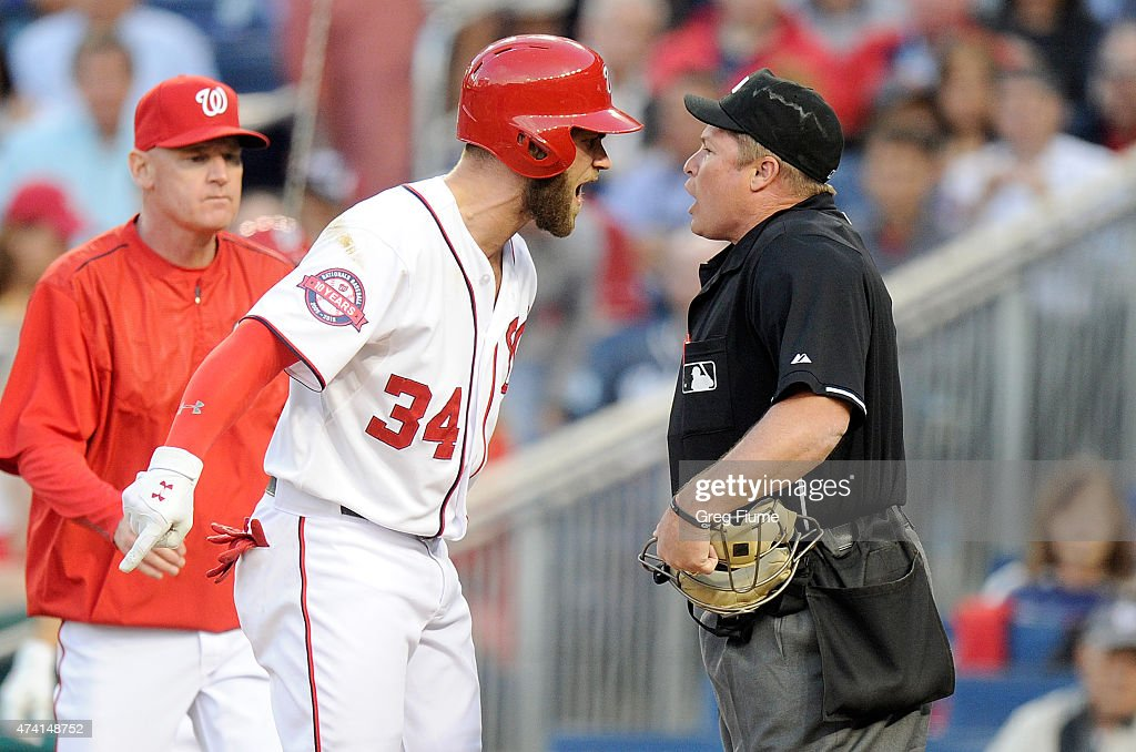 Bryce Harper #34 of the Washington Nationals argues with home plate umpire Marvin Hudson #51 after being thrown out of the game in the third inning against the New York Yankees at Nationals Park on May 20, 2015 in Washington, DC.