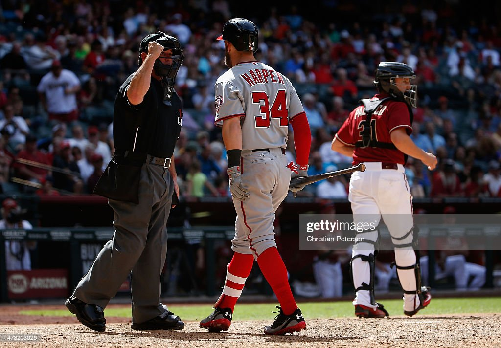 Bryce Harper of the Washington Nationals argues with homeplate umpire Rob Drake before being ejected during the seventh inning of the MLB game...