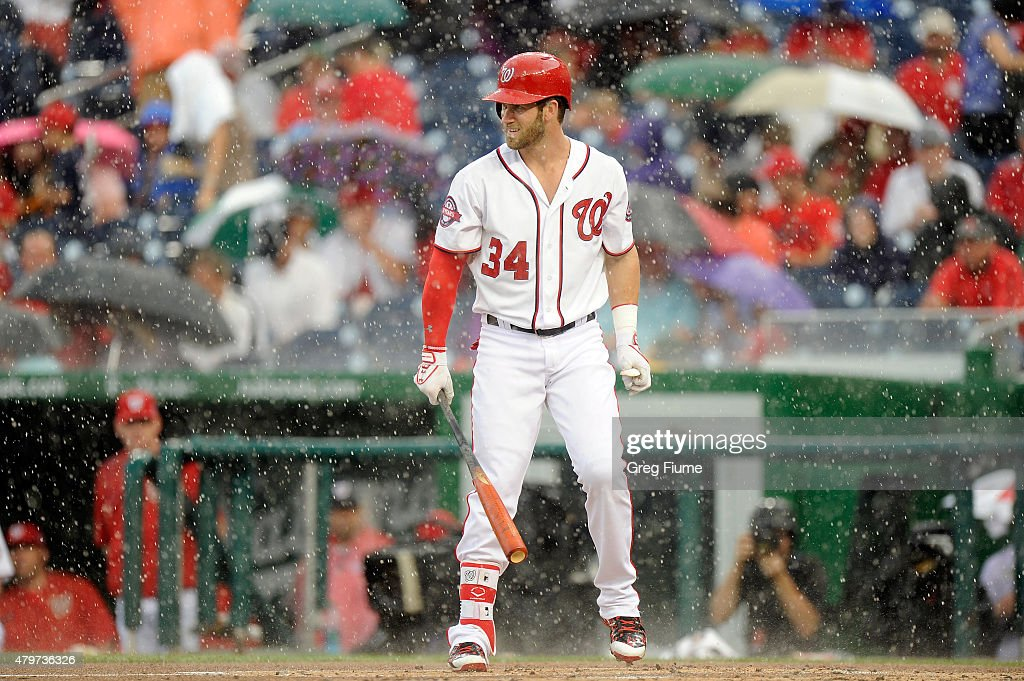 <a gi-track='captionPersonalityLinkClicked' href=/galleries/search?phrase=Bryce+Harper&family=editorial&specificpeople=5926486 ng-click='$event.stopPropagation()'>Bryce Harper</a> #34 of the Washington Nationals at bat when play is stopped for a rain delay in the first inning of the game against the Cincinnati Reds at Nationals Park on July 6, 2015 in Washington, DC.