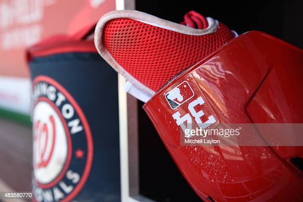 Bryce Harper of the Washington Nationals batting helmet in the dug out before a baseball game against the New York Mets at Nationals Park on July 22...