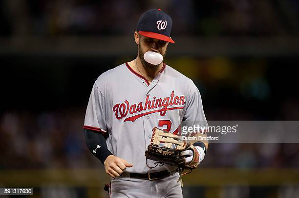 Bryce Harper of the Washington Nationals blows a bubble gum bubble as he runs off the field after the fourth inning of a game against the Colorado...
