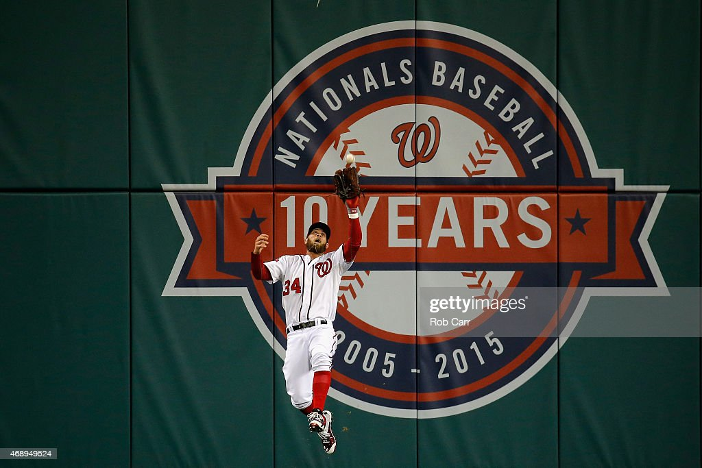 <a gi-track='captionPersonalityLinkClicked' href=/galleries/search?phrase=Bryce+Harper&family=editorial&specificpeople=5926486 ng-click='$event.stopPropagation()'>Bryce Harper</a> #34 of the Washington Nationals catches a ball hit by David Wright #5 of the New York Mets (not pictured) for an out in the first inning at Nationals Park on April 8, 2015 in Washington, DC.