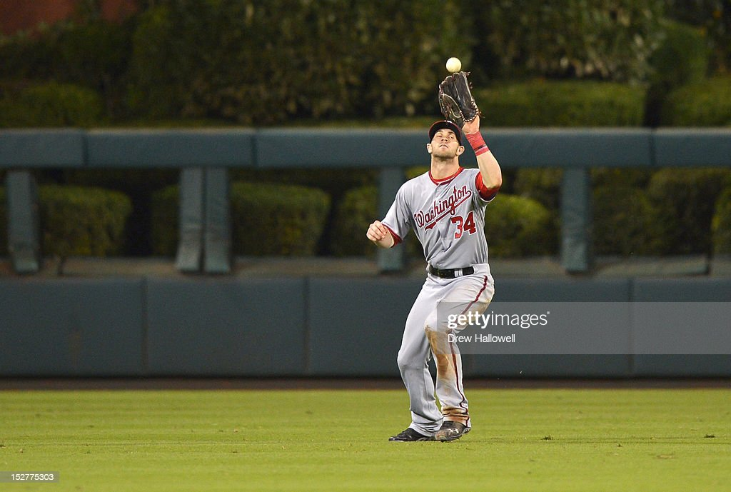 <a gi-track='captionPersonalityLinkClicked' href=/galleries/search?phrase=Bryce+Harper&family=editorial&specificpeople=5926486 ng-click='$event.stopPropagation()'>Bryce Harper</a> #34 of the Washington Nationals catches a fly ball during the game against the Philadelphia Phillies at Citizens Bank Park on September 25, 2012 in Philadelphia, Pennsylvania. The Phillies won 6-3.
