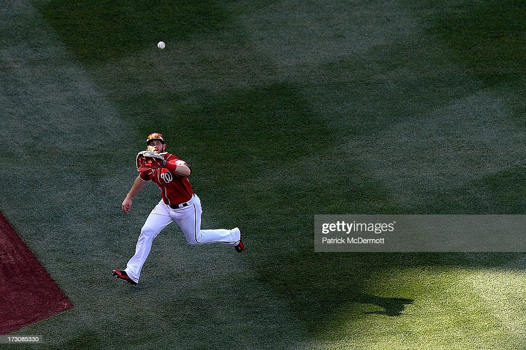 <a gi-track='captionPersonalityLinkClicked' href=/galleries/search?phrase=Bryce+Harper&family=editorial&specificpeople=5926486 ng-click='$event.stopPropagation()'>Bryce Harper</a> #34 of the Washington Nationals catches a fly ball hit by Everth Cabrera #2 of the San Diego Padres in the fifth inning during a game at Nationals Park on July 6, 2013 in Washington, DC.