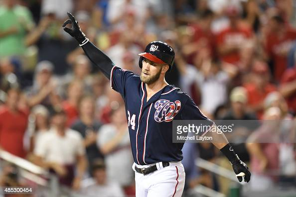 Bryce Harper of the Washington Nationals celebrates a home run during a baseball game against the Milwaukee Brewers at Nationals Park on August 21...