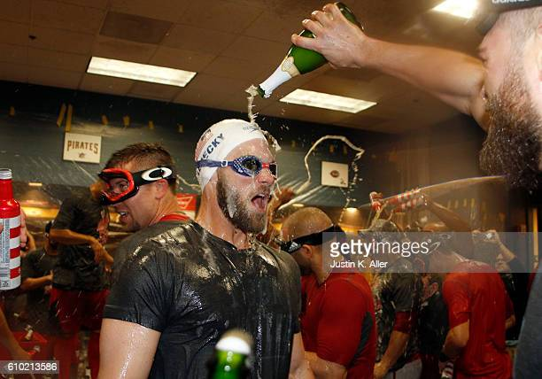 Bryce Harper of the Washington Nationals celebrates after clinching the National League East Division Championship after defeating the Pittsburgh...