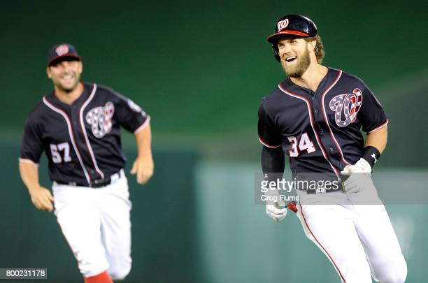 Bryce Harper of the Washington Nationals celebrates after driving in the game winning run with a single in the 10th inning against the Cincinnati...