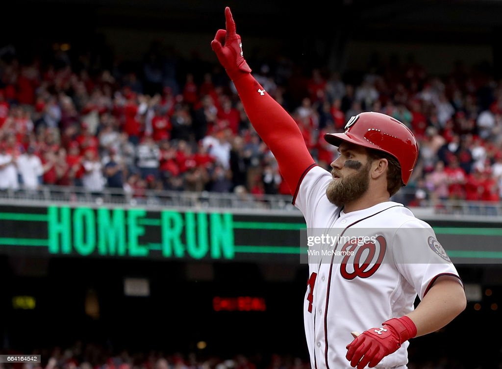 Bryce Harper #34 of the Washington Nationals celebrates after hitting a home run in the sixth inning of the Opening Day game against the Miami Marlins on April 3, 2017 at Nationals Park in Washington, DC.