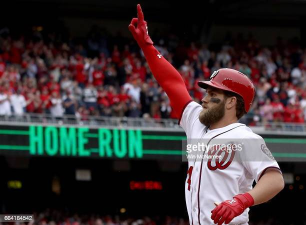 Bryce Harper of the Washington Nationals celebrates after hitting a home run in the sixth inning of the Opening Day game against the Miami Marlins on...