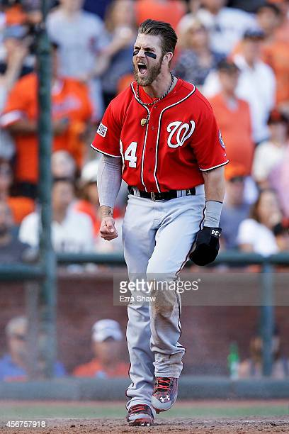 Bryce Harper of the Washington Nationals celebrates after scoring on a throwing error by Madison Bumgarner of the San Francisco Giants in the seventh...