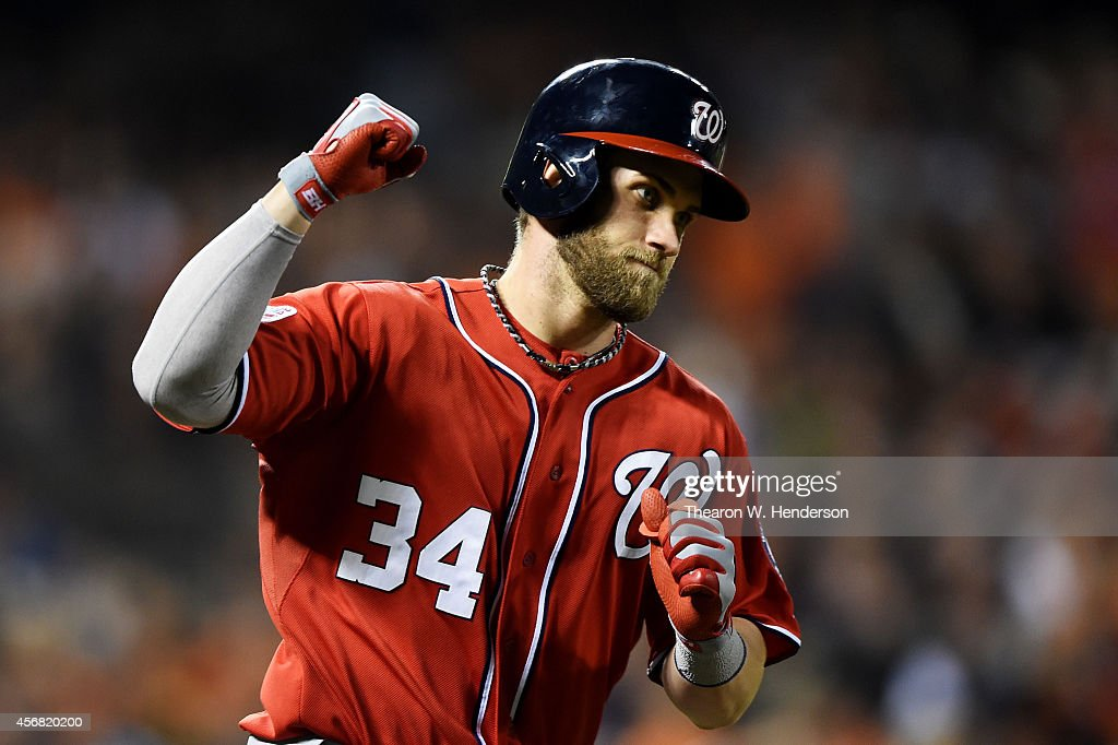 <a gi-track='captionPersonalityLinkClicked' href=/galleries/search?phrase=Bryce+Harper&family=editorial&specificpeople=5926486 ng-click='$event.stopPropagation()'>Bryce Harper</a> #34 of the Washington Nationals celebrates as he rounds the bases on his solo home run in the seventh inning against the San Francisco Giants during Game Four of the National League Division Series at AT&T Park on October 7, 2014 in San Francisco, California.