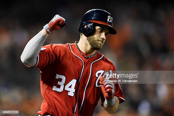 Bryce Harper of the Washington Nationals celebrates as he rounds the bases on his solo home run in the seventh inning against the San Francisco...