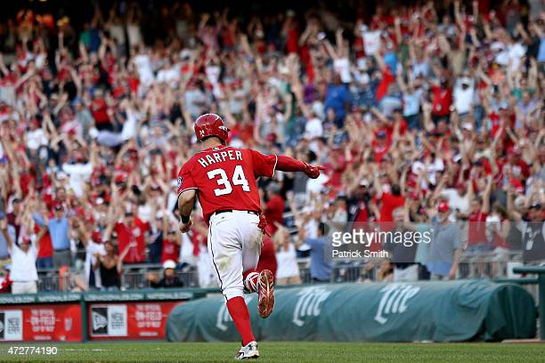 Bryce Harper of the Washington Nationals celebrates as he rounds the bases after hitting a walk off home run in the ninth inning against the Atlanta...