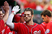 Bryce Harper of the Washington Nationals celebrates his home run with teammates in the seventh inning against the San Francisco Giants during Game...