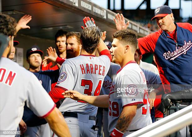 Bryce Harper of the Washington Nationals celebrates his second inning two run home run against the New York Mets at Citi Field on August 12 2014 in...