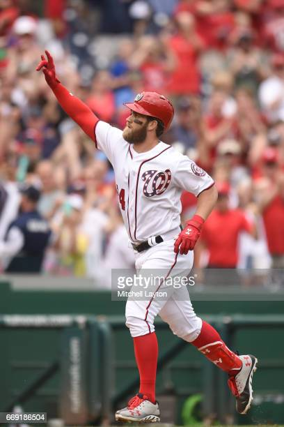 Bryce Harper of the Washington Nationals celebrates hitting a game winning three run home run in the ninth inning during a baseball game against the...