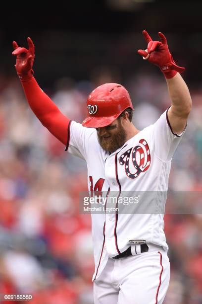 Bryce Harper of the Washington Nationals celebrates hitting a game winning three run home run in the ninth inning after a baseball game against the...