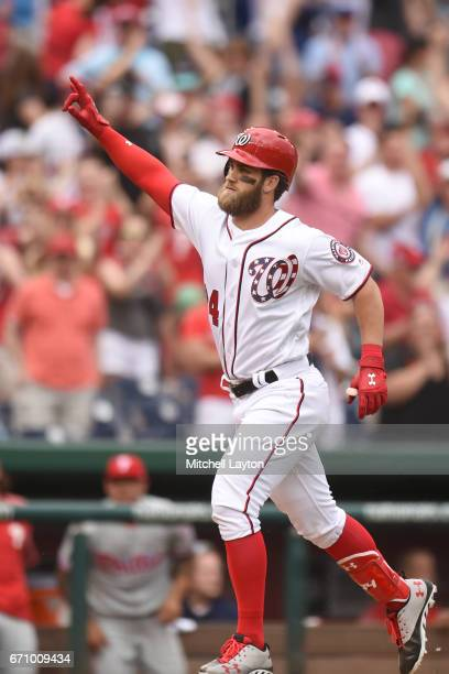 Bryce Harper of the Washington Nationals celebrates hitting a game winning walk off home run during the game against the Philadelphia Phillies at...