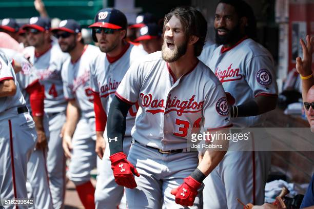 Bryce Harper of the Washington Nationals celebrates in the dugout after a threerun home run in the first inning of a game against the Cincinnati Reds...