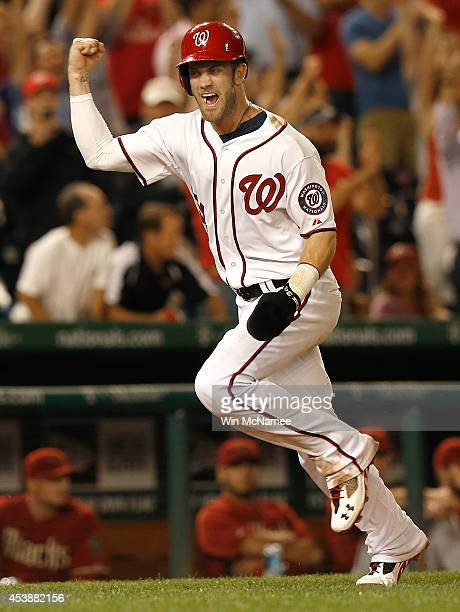 Bryce Harper of the Washington Nationals celebrates while scoring the winning run in the ninth inning against the Arizona Diamondbacks at Nationals...