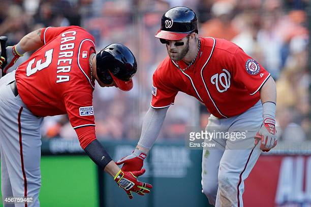 Bryce Harper of the Washington Nationals celebrates with Asdrubal Cabrera after hitting a solo home run in the ninth inning against the San Francisco...