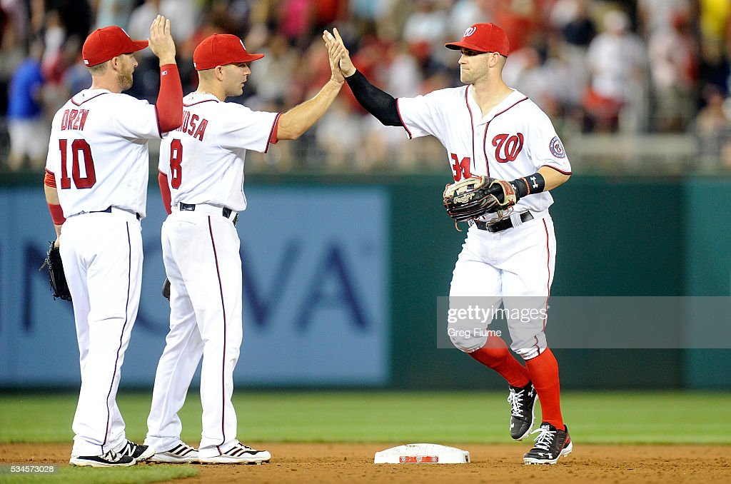<a gi-track='captionPersonalityLinkClicked' href=/galleries/search?phrase=Bryce+Harper&family=editorial&specificpeople=5926486 ng-click='$event.stopPropagation()'>Bryce Harper</a> #34 of the Washington Nationals celebrates with <a gi-track='captionPersonalityLinkClicked' href=/galleries/search?phrase=Danny+Espinosa&family=editorial&specificpeople=4410764 ng-click='$event.stopPropagation()'>Danny Espinosa</a> #8 after a 2-1 victory against the St. Louis Cardinals at Nationals Park on May 26, 2016 in Washington, DC.
