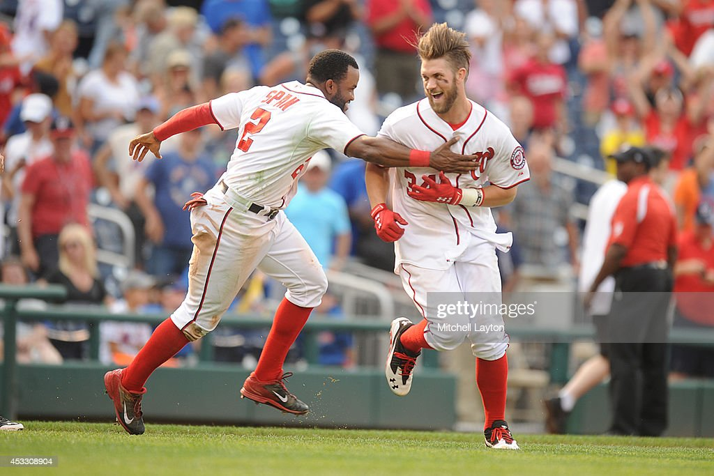 <a gi-track='captionPersonalityLinkClicked' href=/galleries/search?phrase=Bryce+Harper&family=editorial&specificpeople=5926486 ng-click='$event.stopPropagation()'>Bryce Harper</a> #34 of the Washington Nationals celebrates with <a gi-track='captionPersonalityLinkClicked' href=/galleries/search?phrase=Denard+Span&family=editorial&specificpeople=835844 ng-click='$event.stopPropagation()'>Denard Span</a> #2 after hitting a two run walk off home run in the 13th inning during a baseball game against the New York Mets on August 7, 2014 at Nationals Park in Washington, DC. The Nationals won6-3 in the 13th inning.