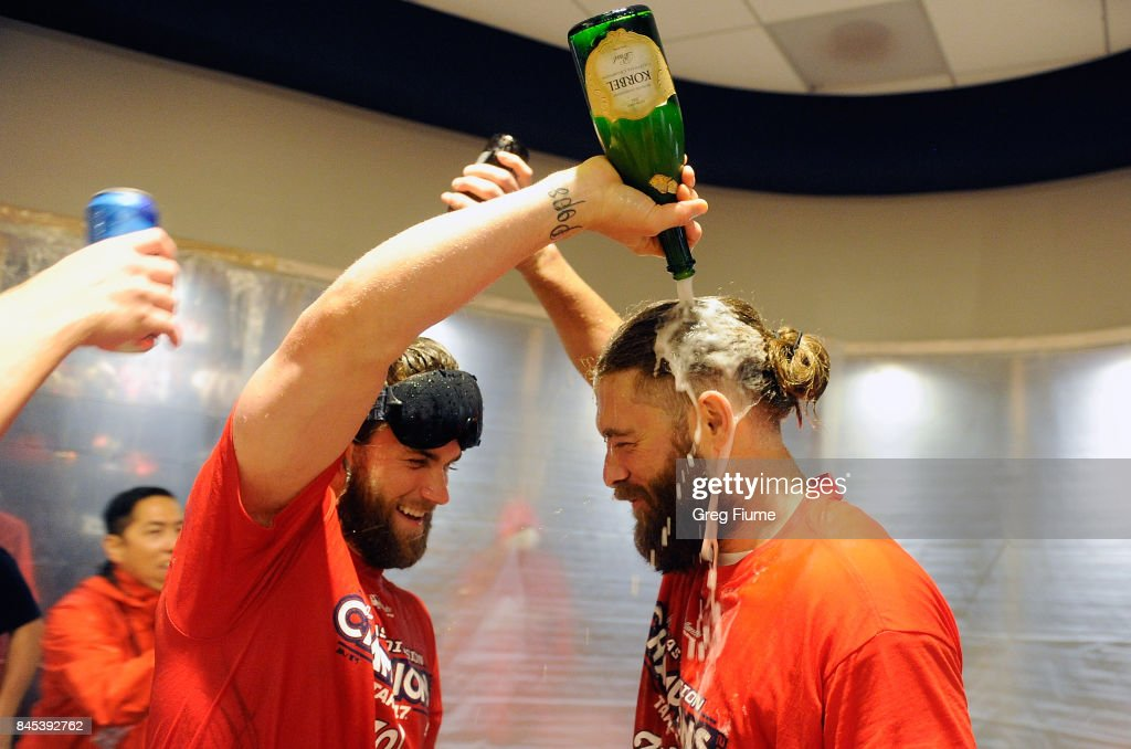 Bryce Harper #34 of the Washington Nationals celebrates with Jayson Werth #28 after clinching the National League East against the Philadelphia Phillies at Nationals Park on September 10, 2017 in Washington, DC.