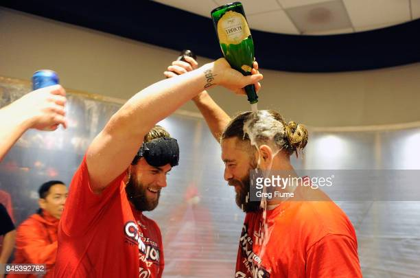 Bryce Harper of the Washington Nationals celebrates with Jayson Werth after clinching the National League East against the Philadelphia Phillies at...