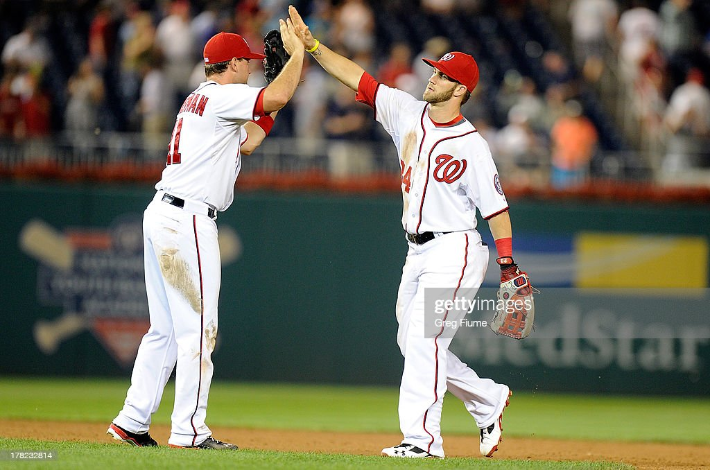 <a gi-track='captionPersonalityLinkClicked' href=/galleries/search?phrase=Bryce+Harper&family=editorial&specificpeople=5926486 ng-click='$event.stopPropagation()'>Bryce Harper</a> #34 of the Washington Nationals celebrates with <a gi-track='captionPersonalityLinkClicked' href=/galleries/search?phrase=Ryan+Zimmerman+-+Baseball+Player&family=editorial&specificpeople=534809 ng-click='$event.stopPropagation()'>Ryan Zimmerman</a> #11 after a 2-1 victory against the Miami Marlins at Nationals Park on August 27, 2013 in Washington, DC.