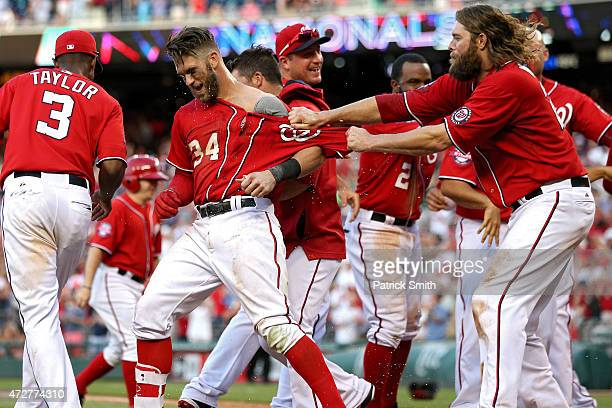 Bryce Harper of the Washington Nationals celebrates with teammates after hitting a walk off home run in the ninth inning against the Atlanta Braves...