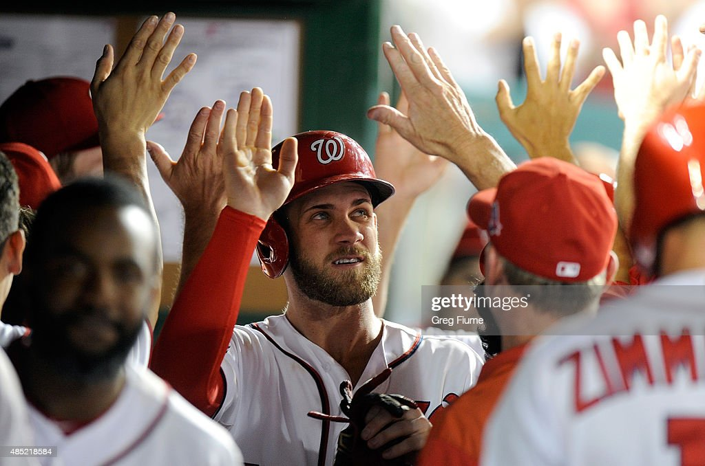 Bryce Harper #34 of the Washington Nationals celebrates with teammates after scoring in the sixth inning against the San Diego Padres at Nationals Park on August 25, 2015 in Washington, DC.