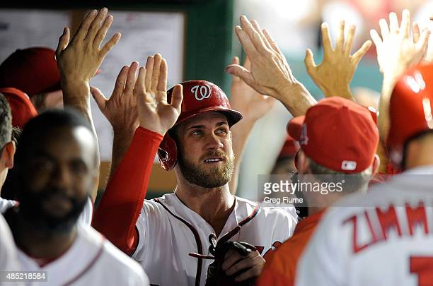 Bryce Harper of the Washington Nationals celebrates with teammates after scoring in the sixth inning against the San Diego Padres at Nationals Park...