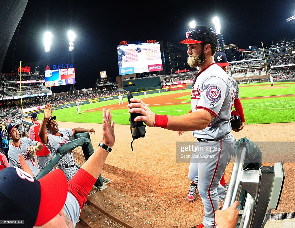 Bryce Harper #34 of the Washington Nationals celebrates with teammates after scoring a sixth-inning run against the Atlanta Braves at SunTrust Park on April 20, 2017 in Atlanta, Georgia.