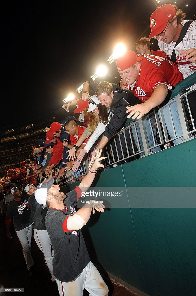 <a gi-track='captionPersonalityLinkClicked' href=/galleries/search?phrase=Bryce+Harper&family=editorial&specificpeople=5926486 ng-click='$event.stopPropagation()'>Bryce Harper</a> #34 of the Washington Nationals celebrates with the crowd after winning the National League East Division Championship after the game against the Philadelphia Phillies at Nationals Park on October 1, 2012 in Washington, DC.