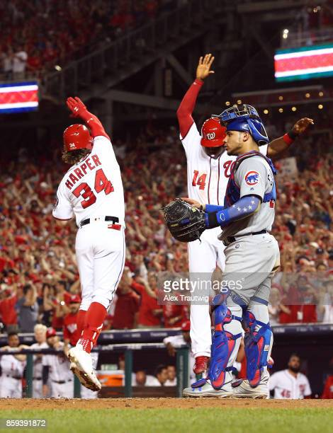 Bryce Harper of the Washington Nationals celebrates with Victor Robles after hitting an eighth inning tworun home run during Game 2 of the National...
