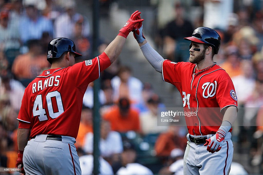 Bryce Harper #34 of the Washington Nationals celebrates with Wilson Ramos #40 after hitting a solo home run in the ninth inning against the San Francisco Giants during Game Three of the National League Division Series at AT&T Park on October 6, 2014 in San Francisco, California.
